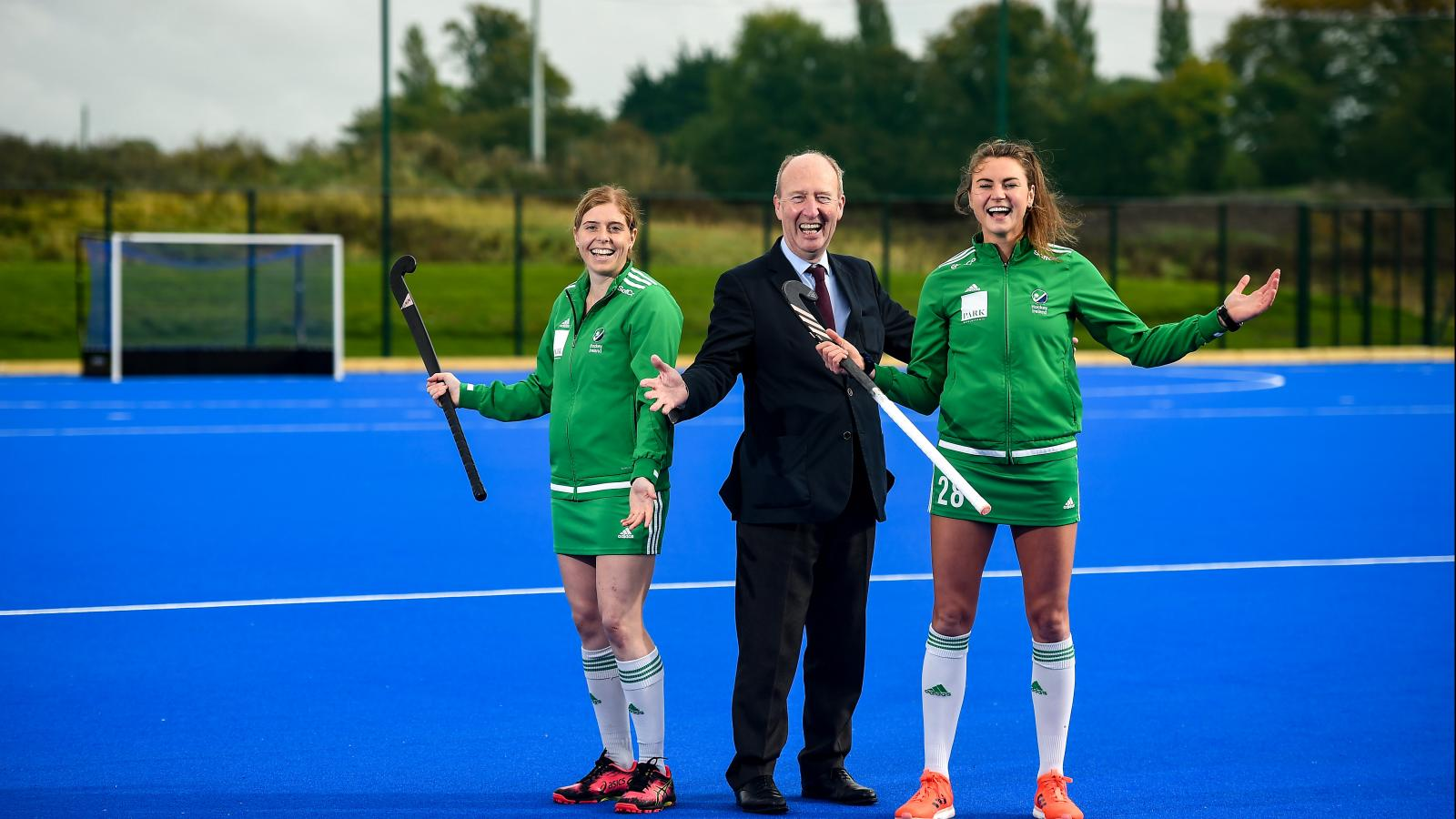 Minister for Transport, Tourism and Sport, Shane Ross TD and Irish International Hockey Players Katie Mullan and Deirdre Duke open the new state of the art hockey pitch at the Sport Ireland Campus